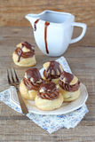Chocolate mousse profiteroles Royalty Free Stock Images
