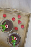Chocolate mousse with raspberries on the table Royalty Free Stock Photography