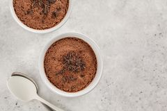 Chocolate mousse from aquafaba, top view. Vegan chickpea dessert. Chocolate mousse souffle from aquafaba. Vegan chickpea dessert. Clean eating concept stock image