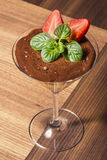 Chocolate mousse with strawberries and mint leaves Royalty Free Stock Photography