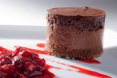 Chocolate mousse with strawberry sauce. Over elegant dish Stock Images