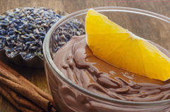 Chocolate mousse topped with Orange fruit Royalty Free Stock Images