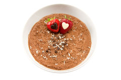 Chocolate mousse with two strawberries. Picture of some chocolate mousse with strawberries with hearts inside them Stock Image