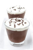 Chocolate mousse with whipped cream on white background Stock Images