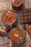 Chocolate mousse. On wood background stock photos