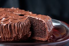 Chocolate Mud Cake on black background. Chocolate Mud Cake on red serve dish on black background Royalty Free Stock Photos