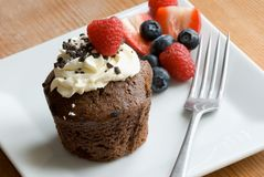 Chocolate muffin. With cream and fruit Stock Photography