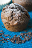 Chocolate Muffin. Selective focus image of a chocolate muffin with blue background Stock Photos