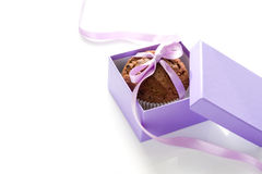 Chocolate Muffin. Tied with purple ribbon in a gift box on white background Stock Image