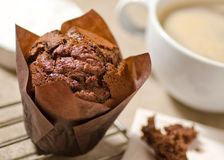 Chocolate Muffin. A dark chocolate muffin with coffee Stock Photo