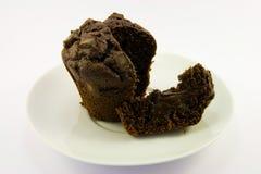 Chocolate Muffin. Single dark chocolate muffin with a white background Stock Photo