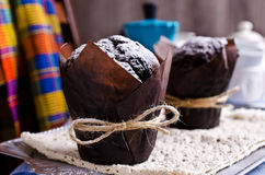 Chocolate muffin in baking paper Royalty Free Stock Photos