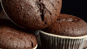 Chocolate muffin on black background stock video