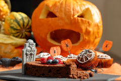 Chocolate muffin cake with spider web on Halloween day Stock Photo