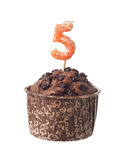 Chocolate muffin with candle for five year old. Chocolate muffin with birthday candle for five year old isolated on white background Royalty Free Stock Photos