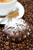 Chocolate muffin and cappuccino with brown sugar on coffee beans Royalty Free Stock Images