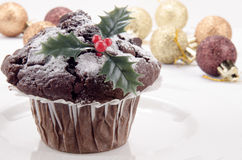 Chocolate muffin with christmas decoration Stock Images