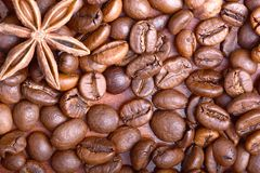 Chocolate muffin, coffee beans, cinnamon, star anise on sacking background. Stock Image