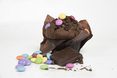 Chocolate muffin. With colorful bonbons Royalty Free Stock Image