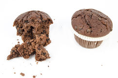 Chocolate muffin and crumbs. Sweet food - Dessert - Chocolate muffin and crumbs - Isolated on white - American style Stock Photos