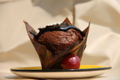 Chocolate muffin. Delicious chocolate muffin on a plate Stock Image