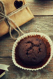 Chocolate muffin, gift box and heart shape Stock Photo