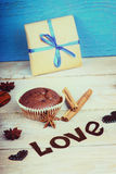 Chocolate muffin, gift box, heart shape and word love Royalty Free Stock Photos