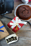 Chocolate muffin, gift boxes and label with word Love Royalty Free Stock Photos