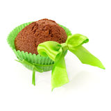 Chocolate muffin in green paper cup Stock Images