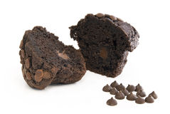 Chocolate Muffin halves. Chocolate Muffin with pieces in front on white background royalty free stock photos