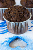 Chocolate muffin and heart. Chocolate muffins on the board written under gzhel Royalty Free Stock Images