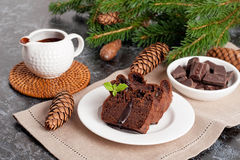 Chocolate muffin with holiday decorations on a dark background Royalty Free Stock Photos