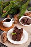 Chocolate muffin with holiday decorations on a dark background royalty free stock images