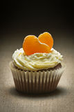 Chocolate muffin  with mandarin and cream Royalty Free Stock Photography