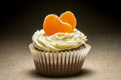 Chocolate muffin  with mandarin and vanilla cream Royalty Free Stock Photography