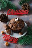 Chocolate muffin and Merry Christmas inscription. Chocolate muffin, branches fir and Merry Christmas inscription. Xmas time. Selective Focus. Copy space Stock Photos