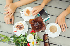 Chocolate muffin with one candle, cups with coffee on wooden tab. Chocolate muffin with one candle, cups with coffee on the wooden table Stock Photo