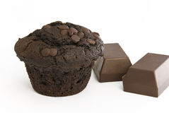Chocolate Muffin with pieces. Chocolate Muffin with two big blocks of milk chocolate stock photography
