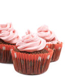 Chocolate muffin with pink cream isolated Royalty Free Stock Images