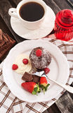 Chocolate muffin served with cream and fresh berris Stock Photography