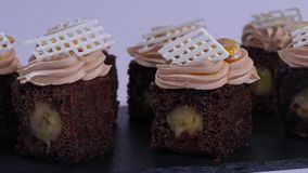 Chocolate muffin with small pieces of mango. Chocolate cupcakes with mango stock video footage