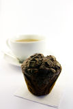 Chocolate Muffin with Tea. Single chocolate muffin with cup of tea with a white background Stock Photography