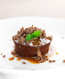 Chocolate muffin with toffee sauce Stock Photography