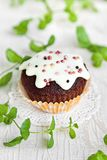 Chocolate muffin with vanilla frosting Royalty Free Stock Photo