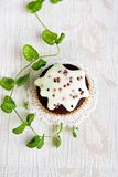 Chocolate muffin with vanilla frosting Stock Image