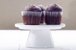 Chocolate muffin on white cake stand Royalty Free Stock Photo