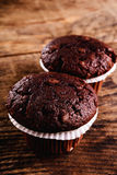 Chocolate muffin. On wood table Royalty Free Stock Image