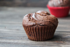 Chocolate muffin. On wood table and magazine Stock Photography