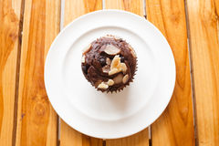 Chocolate muffin on wooden board. Stock Images