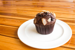 Chocolate muffin on wooden board. Stock Photos